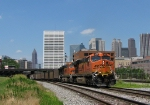 Scherer coal heading past Spring St. with the skyline in the background