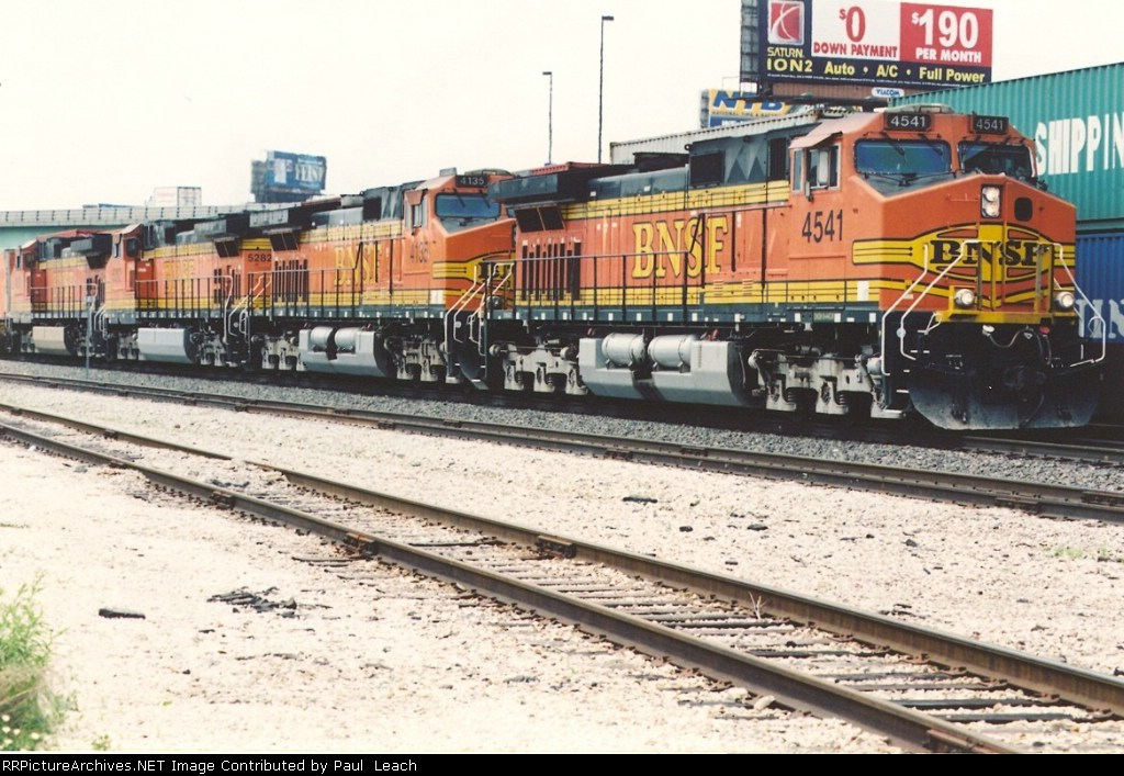 Eastbound stack train passes Union Station