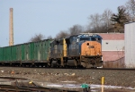 An SD70MAC leads Q703 sounthbound on a sunny winter afternoon.