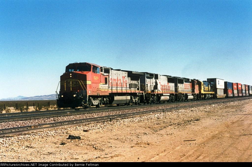 Santa Fe B40-8W #520 (with GP60B #333, BNSF GP60M #103 & SF30C #9547) lead another westbound intermodal