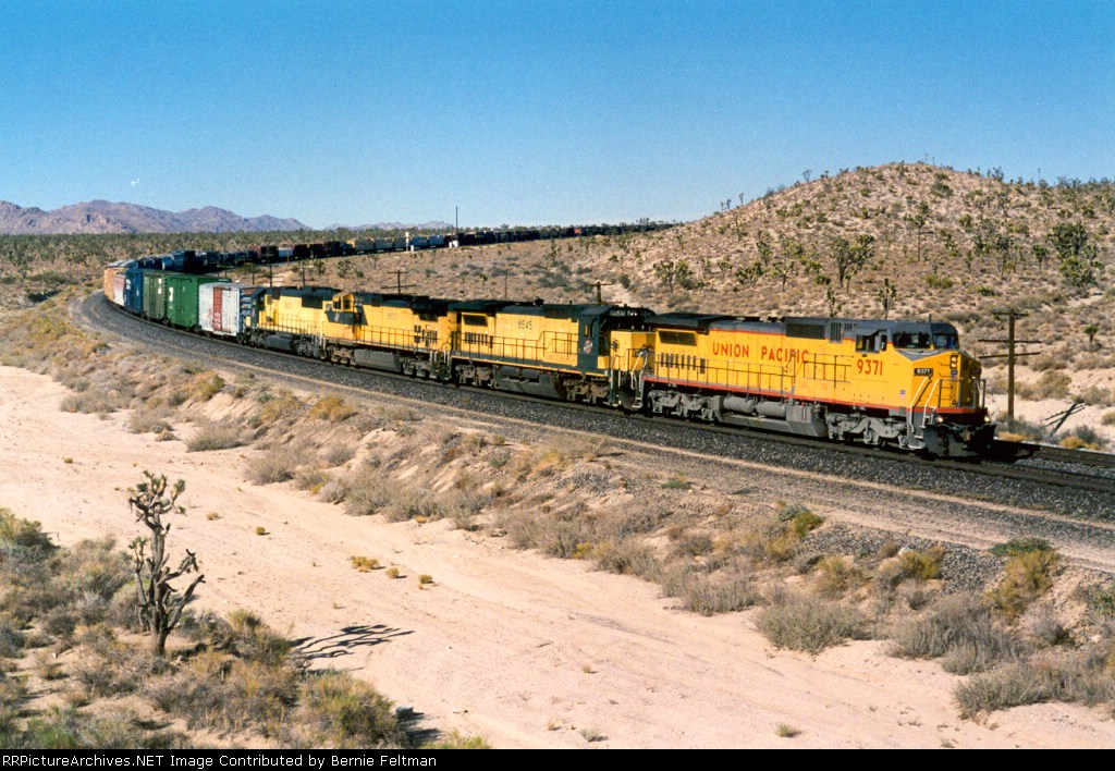 Union Pacific C40-8W #9371 (with C&NW C41-8 #8545, C44-9W #8632 & SD60 #8023) departing the siding