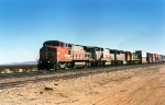 Santa Fe B40-8W #520 (with GP60B #333, BNSF GP60M #103 & SF30C #9547) lead another westbound intermodal