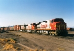 Santa Fe C44-9W's 656 & 661 bracket BNSF SD75M as they lead an eastbound past the depot