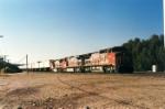 Santa Fe C40-8W #880 leads a J. B. Hunt intermodal train eastbound