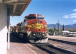 Santa Fe C44-9W #655 (with C40-8W #807, B40-8W #547 & GP60M #125) blasts past the depot with another westbound intermodal train