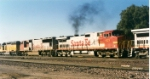 Santa Fe C44-9W #623, in the consist of a westbound, passes the depot