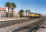 Union Pacific SD60M #6102 (SD60M) leading a container stack train past the depot