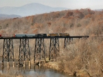 UP 3962 (SD70M) leads mixed freight across the James River trestle with Blue Ridge Mountains in the background