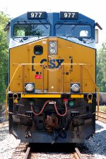 CSX ES44AC #977, serving as sole power for empty Mulberry (FL) bound phosphate train K893, is tied town at the south end of the siding