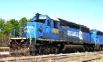 "CSX 8838 (SD40-2) in Conrail Quality paint scheme, with ""Dixie Lines"" rubbed in grime above locomotive bell,"