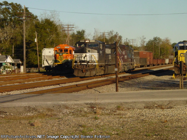 Burlington Northern Santa Fe B40-8 #8636, being used as power for the local, builds its train as Norfolk Southern C40-9W #9300 & HLCX SD40-2 #6100 pass thru the yard, engine light, southbound