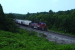 BNSF 111 (GP60M) leads a CSX grain train minutes before nightfall