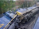 CSX train Q522-06, while stopped on the main track, was struck by CSX Rail Train W019-27