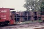 Frisco caboose SLSF# 1421 sits in front of derailed freight cars that have been shoved in the clear of the main line