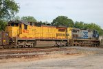CREX C40-8 #9023 and CSX AC44-CW #96 ease train Q551 into the north end of the siding