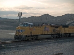 UP 7802 leads a WB doublestack at 6:28am