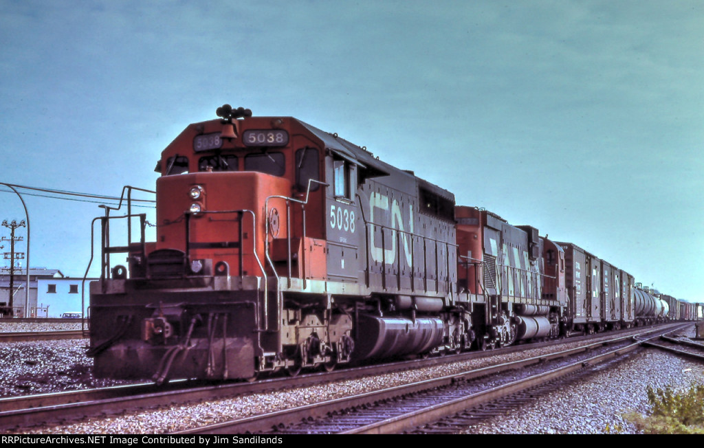 CN 5038 and 2037 westbound at Dorval.