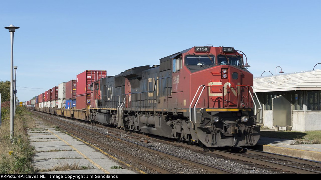 CN 2158 & 5734 on eb intermodal at dorval
