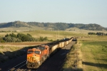 A helper set begins to push BNSF 6088 East up Crawford Hill