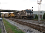 NS 7686 and UP SD70M pull a NS intermodal with autoracks on the head through Hair in downtown Dalton