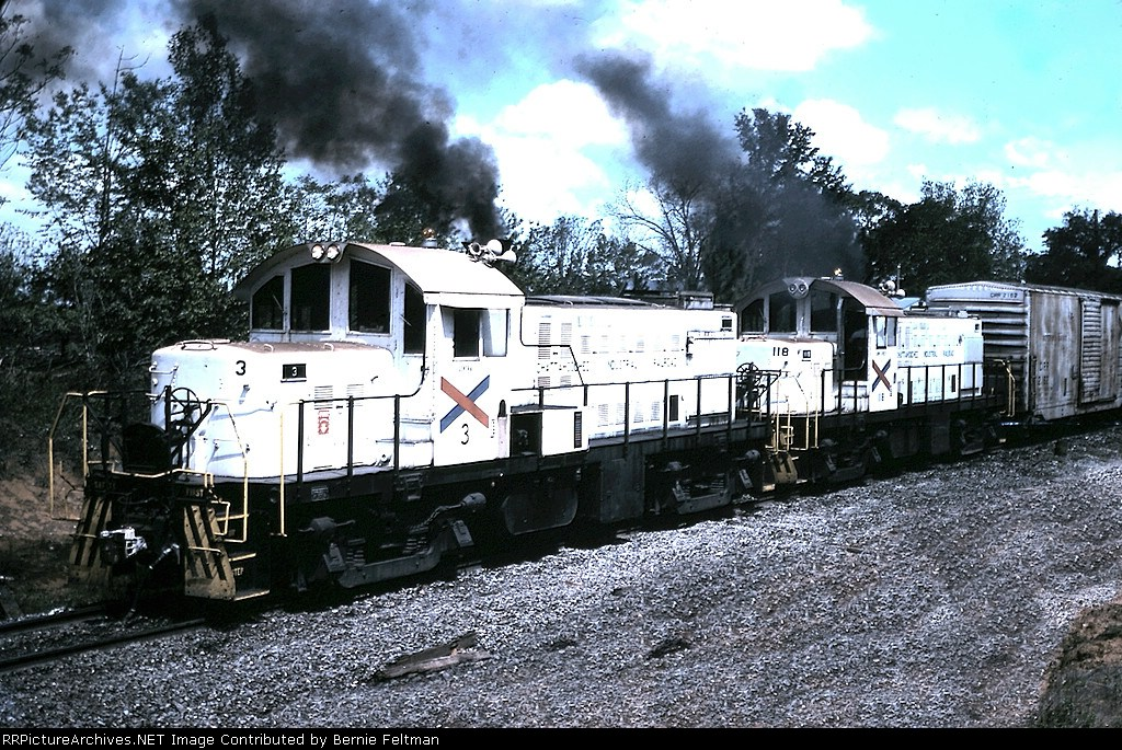 Chattahoochee Industrial Railroad RS1's #3 and 118 work a cut of Seaboard Coast Line interchange cars at the south end of the CIRR yard
