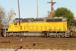 Long-hood view of CEFX SD40-2 #2815 working the east end of the yard