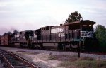Norfolk Southern C39-8's #8638 and 8634 lead #199 past the junction to downtown Moultrie