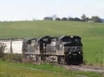 The  44V grain train is moving up a grade at roughly 20 - 25 mph in what sounds like notch 8. Man this is loud!!