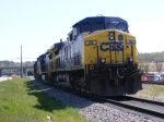 CSXT 54 and 3 other locomotives sit on the siding waiting on their next assignment