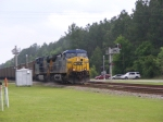 CSXT 521 leads a Northbound Empty Florida Coal Train through town