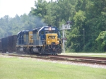 A pair of recent repainted EMDs bring a Northbound Mixed Train into town