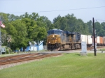 "CSXT 5439 leads a Southbound ""Hot"" Intermodal across Main Street"