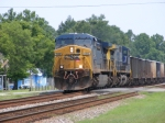 CSXT 586 leads a Southbound loaded rock train through town