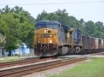 CSXT 586 leads a Southbound loaded rock train through town
