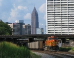 BNSF 5716 barely clears the cloud shadow as it shoves towards Midtown