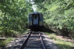QARX 1502, one of several ex-Queen Anne's RR cars nestled in the woods at GED