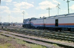1002-A1-014 American Freedom Train is pulled backwards across Hiawatha Ave to MILW Southtown Yard by Baldwin switcher