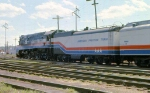 1002-A1-015 American Freedom Train is pulled backwards across Hiawatha Ave to MILW Southtown Yard by Baldwin switcher