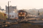 ns 155 drifts past the old southern passenger station coming out of the sun