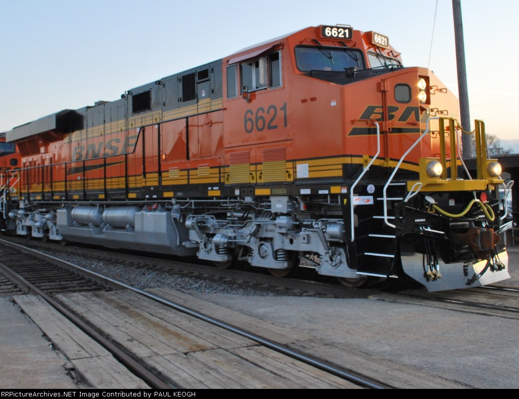 Clsoe up shot of BNSF 6621 on her first revenue run west as the setting sun reflects her new BNSF LOGO!!!