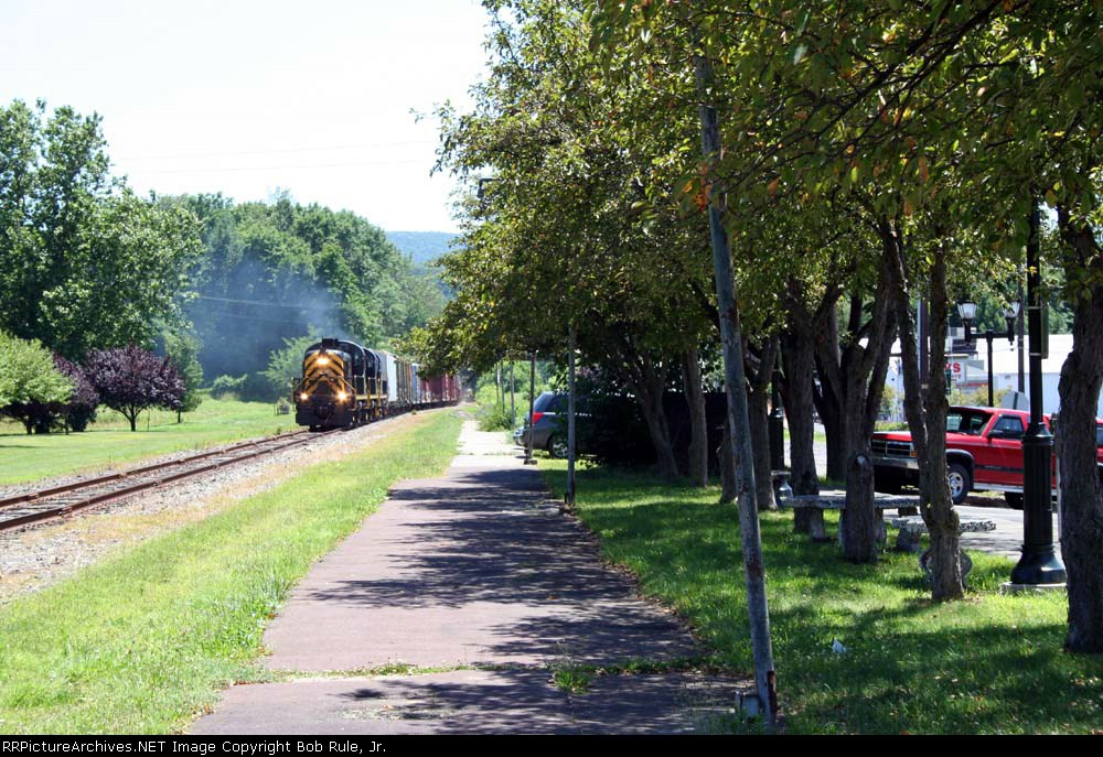 Portland Turn makes a run at the grade,  approaching the East Stroudsburg station area