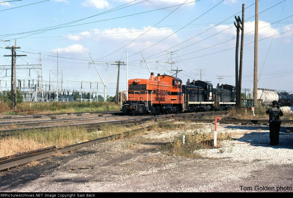 IHB 8792, 8879, and Another Switcher Westbound