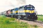 Eastbound grain train approaches yard