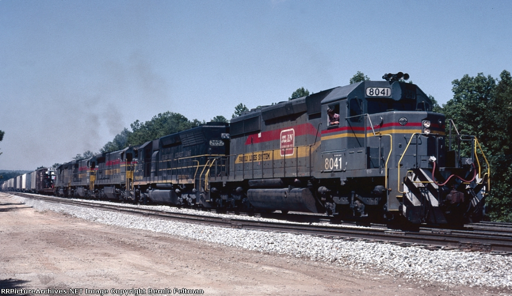 Seaboard System SD40-2 #8041, the lead unit of five six-axle locomotives powering today's train #329, with the engineer notching out his consist and looking back over his train