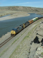 CSX 21 AC44CW entering McAdows Canyon along Yellowstone River
