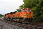 A trio of BNSF units head west with an empty coal train