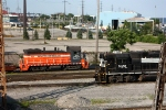 Steel mill power passes a parked NS Geep