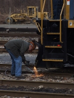 CSX machinist Artie Hanna cutting the plow for third rail clearance
