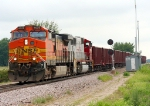 BNSF 4636 backing its ballast train into the siding to let other trains head down the main