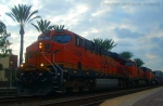 BNSF 7494 Crawling to a Stop by the Santa Fe Cafe